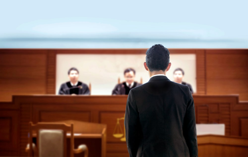 Man in front of Judges